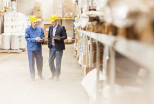 Overcome Disruptions with Intelligent Supply Chain Planning & Optimization > Men in warehouse > Dassault Systèmes®